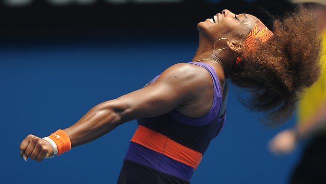Serena Williams of the US celebrates after defeating Spain's Garbine Muguruza in their second round match at the Australian Open tennis championship.