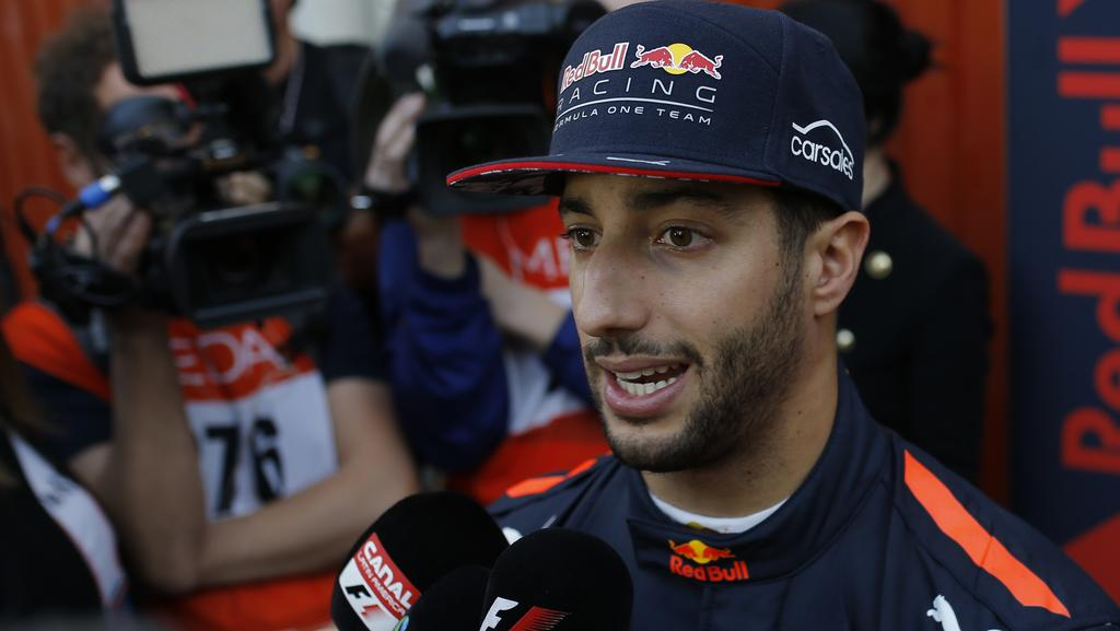Aussie race ace Daniel Ricciardo says he's not impressed by glamorous lifestyles and is equally happy to sleep in a swag. Picture: AP/Francisco Seco