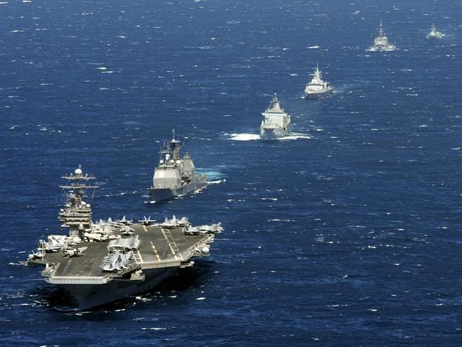 Formidable force ... The aircraft carrier USS Theodore Roosevelt with a protecive force of cruisers, destroyers and frigates. A recent exercise saw this expansive, and expensive, defence force bypassed by a French submarine. Source: USN
