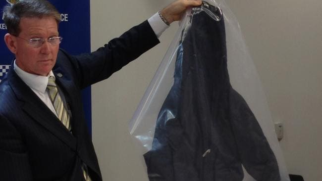 Special Crimes Investigation Branch Superintendent Damian Powell with the jacket found in Golden Grove.