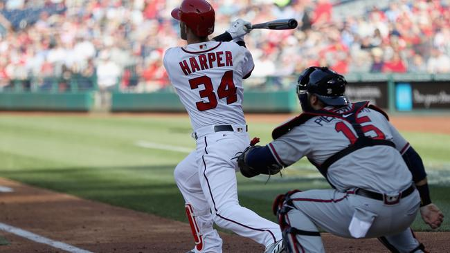 Bryce Harper #34 of the Washington Nationals follows his third inning grand slam.