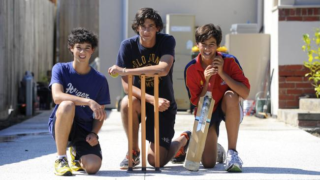 The Agar brothers in 2010: Ashton Agar, then 16, centre, with his brothers Will, then 14, (left) and Wesley, 13, in the driveway of their Melbourne home, where they play cricket. Picture: Hilton Stone