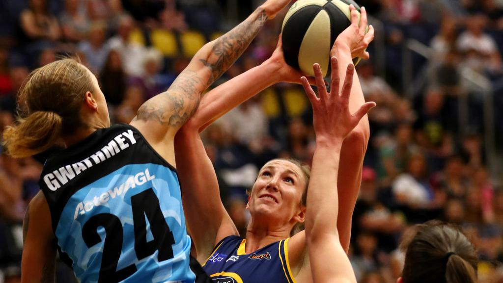 Jennifier Hamson shoots for the Flames against Canberra Capitals. Pic: Gregg Porteous