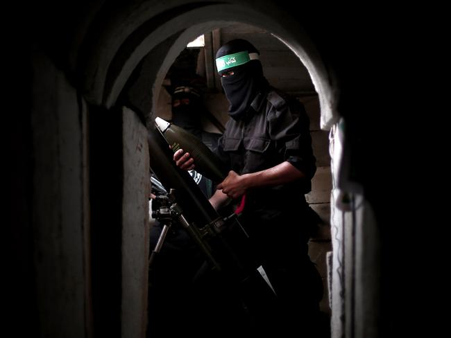 An armed soldier from the Izz ad-Din al-Qassam Brigade, a military wing of Hamas, deploys at a tunnel in Shujaya neighbourhood of Gaza City in August 2014. Picture: Mustafa Hassona / Anadolu Agency