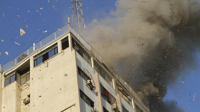 Smoke rises after an Israeli air strike on an office of Hamas television channel Al-Aqsa in Gaza City on Sunday.