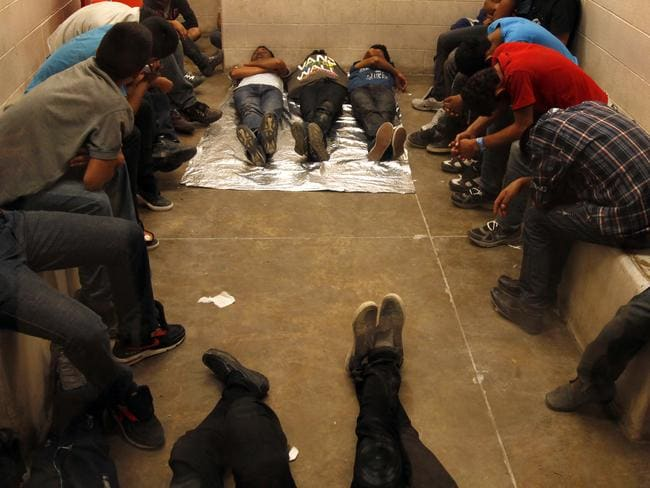 Crowded space ... immigrants who have been detained while crossing the border are held inside the McAllen Border Patrol Station in McAllen, Texas. Picture: Los Angeles Times, Rick Loomis