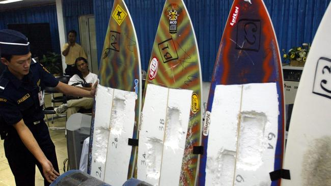 Indonesian customs officers display the surfboards used to smuggle cocaine after Rodrigo Gularte was busted on a run to Bali. Gularte was convicted, and executed. Picture: AP Photo/Dita Alangkara