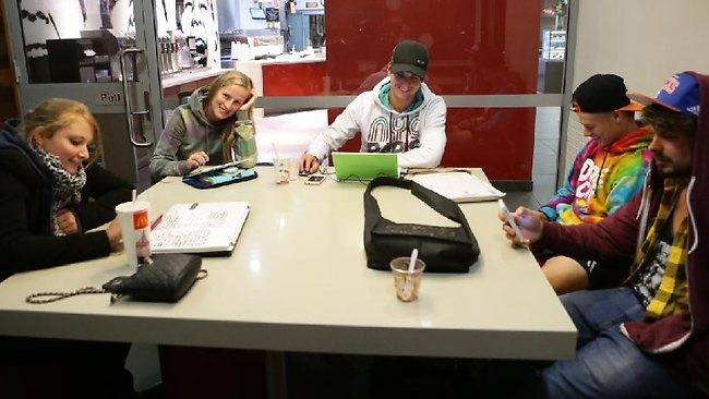 Travelers are using the McDonalds fast food outlet near the Jet Base at the Domestic Airport as overnight accommodation for early flights leaving in the morning. (L-R) Jessica Schaal, Anja Heins, Marius Behringer, Max Roach and Luke Roach.