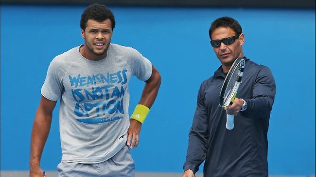 Jo-Wilfried Tsonga of France and his coach Roger Rasheed look on during a practice session ahead of the 2013 Australian Open at Melbourne Park.