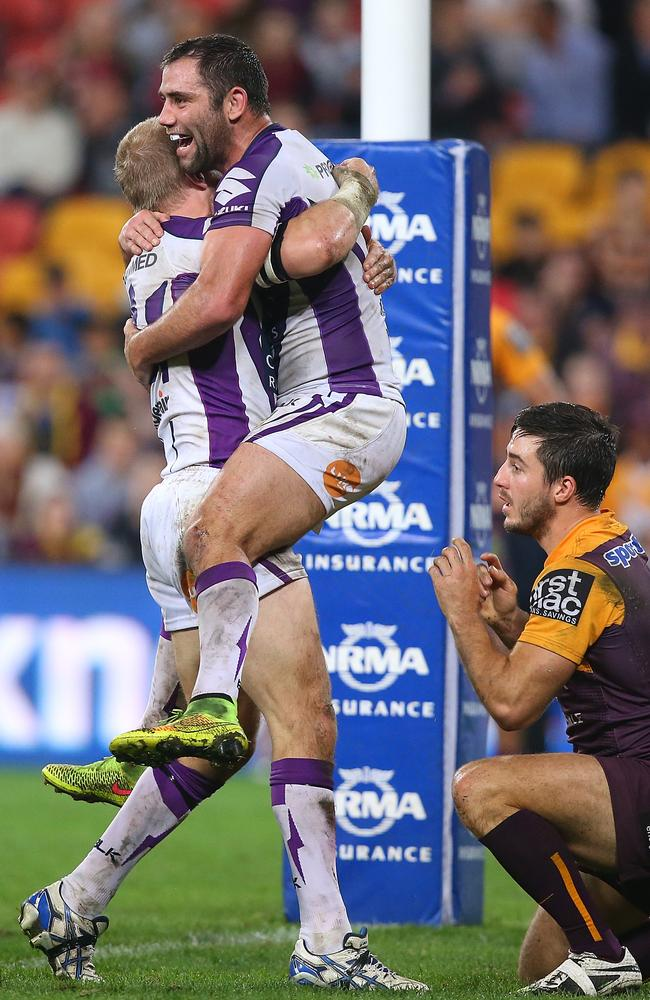 Ryan Hinchcliffe and Cameron Smith celebrate a Storm try against the Brisbane Broncos last week.