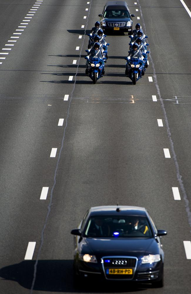 A hearse ... carrying a coffin with human remains collected over the last couple of days at the crash site of flight MH17 in Ukraine is escorted over the highway in Hilversum to the base where the remains are investigated in Hilversum, the Netherlands. Picture: AFP