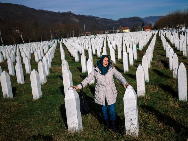 TOPSHOT — A woman mourns over a relative's grave at the memorial centre of Potocari near Srebrenica. Picture: Dimitar DILKOFF
