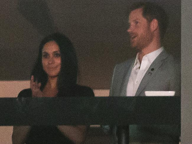 Prince Harry stands with girlfriend Meghan Markle during the Invictus Games closing ceremony in Toronto. Picture: AP