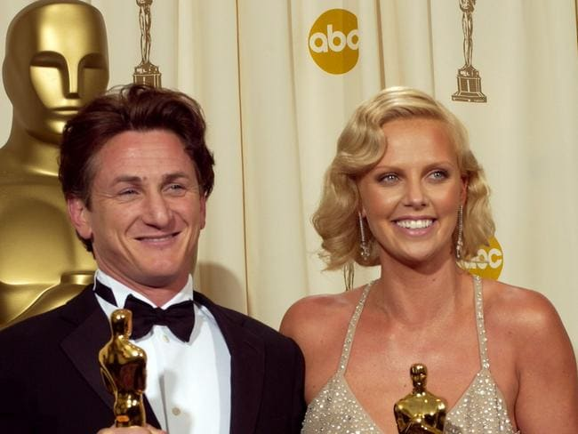 Oscar winners ... Actors Sean Penn and Charlize Theron holds the Oscar they won for best actor and best actor in 2004.