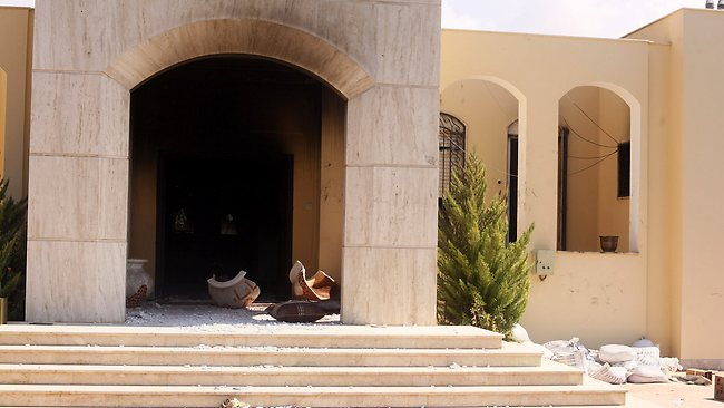 Soot and debris spills out of the U.S. Consulate after an attack by protesters angry over a film that ridiculed Islam's Prophet Muhammad in Benghazi. The US ambassador to Libya and three other Americans were killed. AP / Ibrahim Alaguri