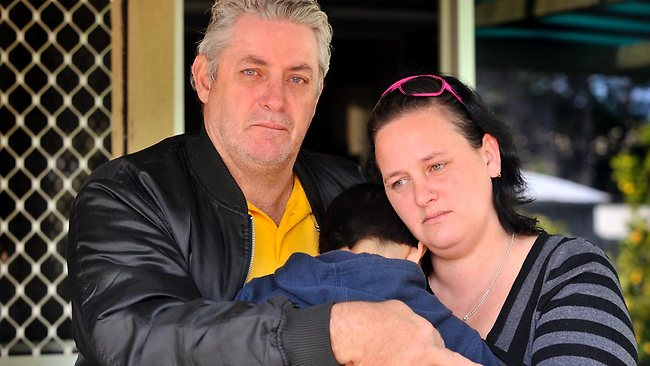 Emma L'Aiguille's 10-year-old son is comforted by her father Wayne Walton and sister Rebecca Walton. Picture: Stewart Allen