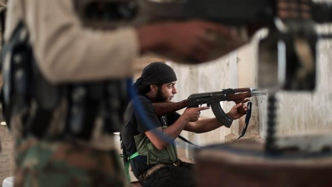 Conflict ... rebel fighters from the Islamic Front, Syria's largest rebel coalition, clash with ISIS militants.