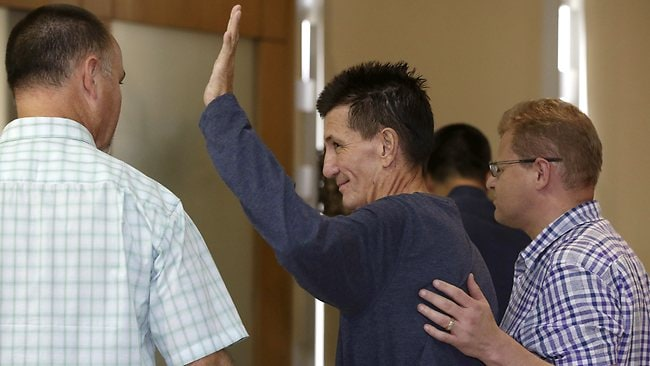 Freed Australian hostage Warren Richard Rodwell, center, waves after meeting reporters at the airport in Manila, Philippines on Monday March 25, 2013. Al-Qaida-linked militants released the emaciated Rodwell March 23 after being held captive for 15 months. (AP Photo/Aaron Favila)