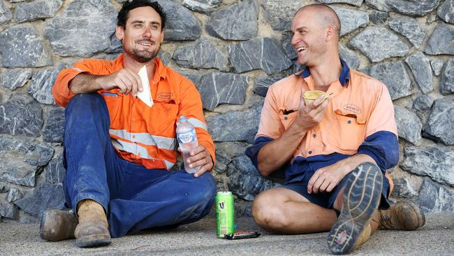 Construction workers Josh Coutts and Adriano Taraborrelli eating lunch onsite in Spring Hill, Brisbane. Picture: Tara Croser.