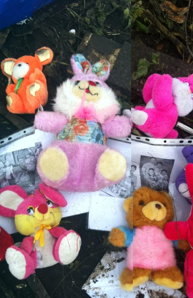 Locals pay tribute: passengers' belongings found at the MH17 crash site and other items brought by locals, including a photocopied image of Mo, Evie and Otis Maslin from Perth, now form a makeshift memorial. Picture: Ella Pellegrini