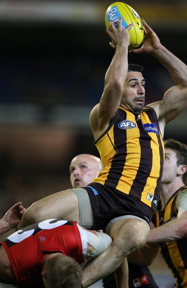 """Up there, Poppy"" — Hawthorn's Paul Puopolo marks over Melbourne's Bernie Vince. Picture: George Salpigtidis"
