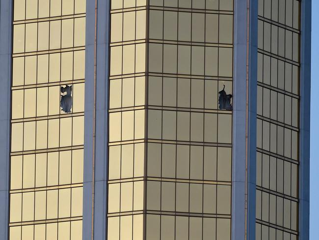 Broken windows on the 32nd floor of the Mandalay Bay Resort and Casino after a lone gunman opened fire on the Route 91 Harvest country music festival. Picture: David Becker/Getty Images/AFP
