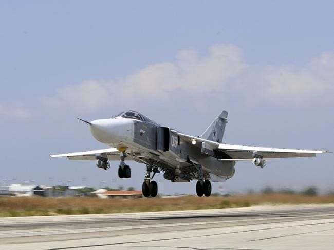 Air traffic ... A Russian SU-24M jet fighter armed with laser guided bombs takes off from a runaway at Hmeimim airbase in Syria. Source: AP