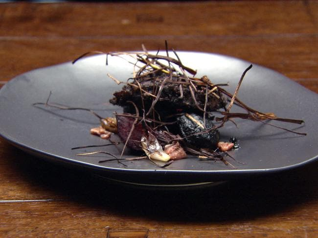 """Nailed our sensory dining experience"" ... Ben Macdonald's Campfire' rib eye with charred leeks, potato in squid ink and smoked anchovies."