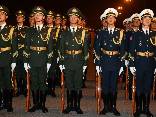 Members of the Chinese army prepare to make a guard of honour for the arrival Mr Abbott. Picture Cameron Richardson.