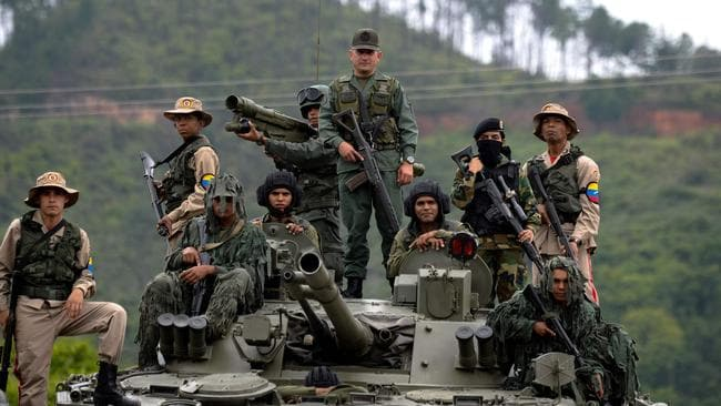 Venezuelan troops stand on top of a Russian tank. Picture: Federico Parra
