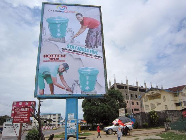 A billboard promotes the washing of hands to prevent the spread of the deadly Ebola virus in Monrovia, Liberia. Picture: Jonathan Paye-Layleh