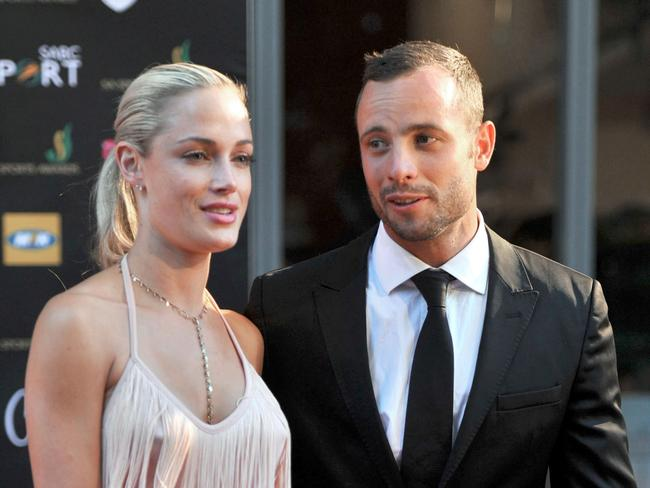 South African Paralympian athlete Oscar Pistorius posing next to his late girlfriend Reeva Steenkamp. Picture: AFP
