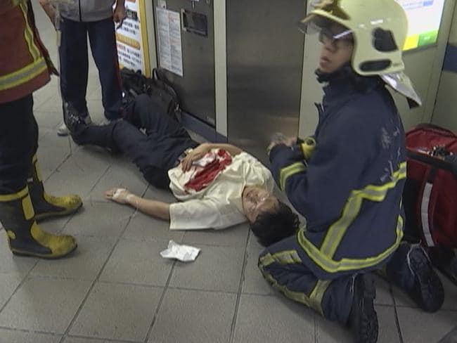 Dozens injured...Paramedics are seen tending to a victim at a subway station in Taipei, Taiwan. Picture: AP/CTV