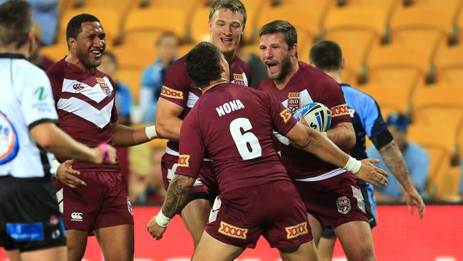 Blake Leary celebrate a try with his Queensland Residents teammates during their win over NSW Residents.