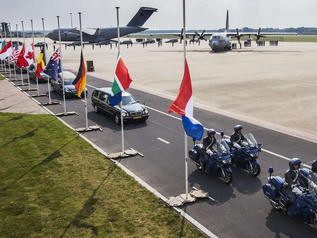 Sad arrival ... with gruelling forensic work to come. Hearses carrying coffins with the remains of the victims of the Malaysian Airlines MH17 plane crash leave Eindhoven military airport.