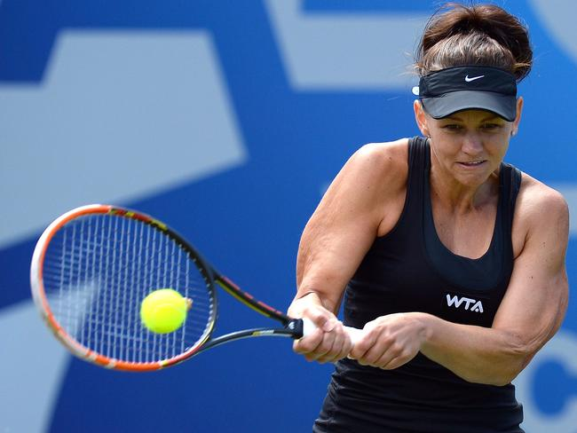 Casey Dellacqua of Australia returns to Urszula Radwanska of Poland.