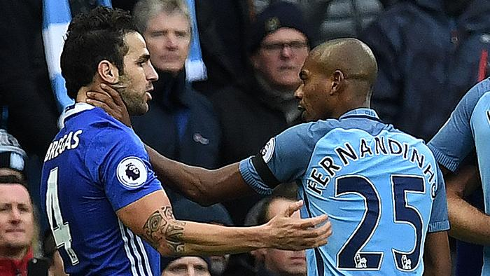Manchester City's Brazilian midfielder Fernandinho (R) fights with Chelsea's Spanish midfielder Cesc Fabregas following Manchester City's Argentinian striker Sergio Aguero's challenge on Chelsea's Brazilian defender David Luiz during the English Premier League football match between Manchester City and Chelsea at the Etihad Stadium in Manchester, north west England, on December 3, 2016. / AFP PHOTO / Paul ELLIS / RESTRICTED TO EDITORIAL USE. No use with unauthorized audio, video, data, fixture lists, club/league logos or 'live' services. Online in-match use limited to 75 images, no video emulation. No use in betting, games or single club/league/player publications. /