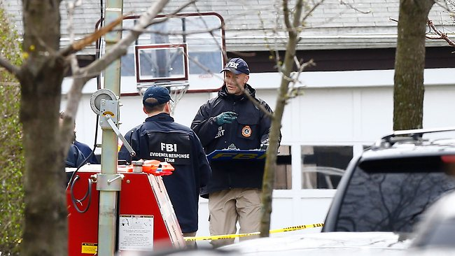 WATERTOWN, MA - APRIL 20: Different members of law enforcement investigate the scene where bombing suspect was caught last night on Franklin Street on April 20, 2013 in Watertown, Massachusetts. A manhunt for Dzhokhar A. Tsarnaev, 19, a suspect in the Boston Marathon bombing ended after he was apprehended on a boat parked on a residential property in Watertown, Massachusetts. His brother Tamerlan Tsarnaev, 26, the other suspect, was shot and killed after a car chase and shootout with police. The bombing, on April 15 at the finish line of the marathon, killed three people and wounded at least 170. Jared Wickerham/Getty Images/AFP== FOR NEWSPAPERS, INTERNET, TELCOS & TELEVISION USE ONLY ==