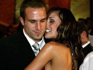 Footballer Chris Judd hugging with girlfriend Rebecca Twigley after winning Brownlow Medal at presentation in Melbourne 20 Sep 2004.