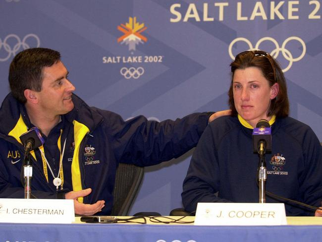 Chef de Mission Ian Chesterman comforts injured aerial skier Jacqui Cooper at the 2002 Games.