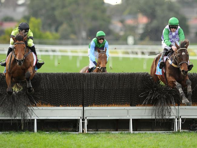 John Allen and Wells (right) negotiate the last with Steven Pateman and Bashboy. Picture: Getty Images