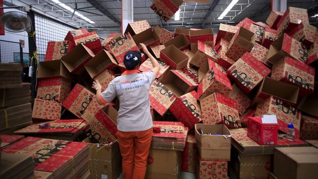 An employee at an Alibaba Tmall logistic centre getting ready for the event in 2015. Picture: Reuters