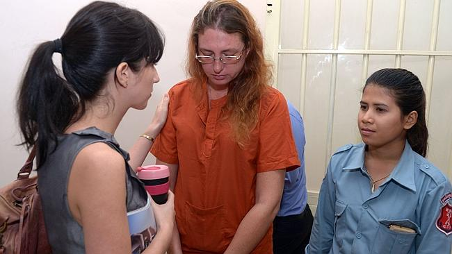 Upset ... Australian woman Yoshe Ann Taylor sobs as she speaks to an official of the Australia Embassy at the Phnom Penh municipal court.