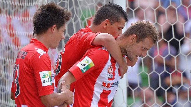 Melbourne Heart players celebrate Nick Kalmar's goal in the first half. Picture: George Salpigtidis