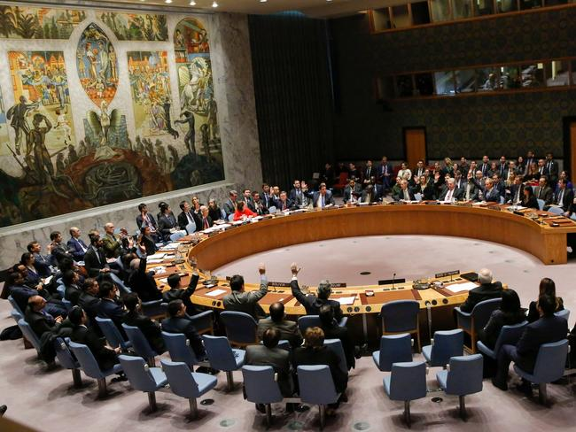 Members of the UN Security Council raise their hands as they vote on a draft resolution that would reject US President Donald Trump's decision to recognise Jerusalem as the capital of Israel. Picture: AFP