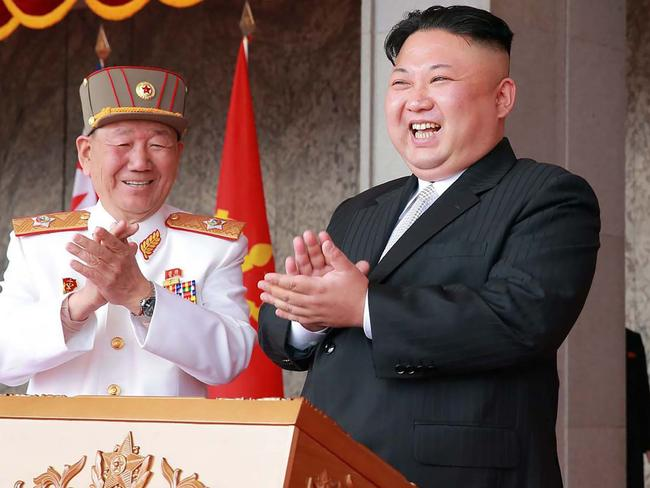 "A smirking Kim Jong-un watched a fervent military parade just hours after telling America: ""We're ready for war."" Picture: AFP"