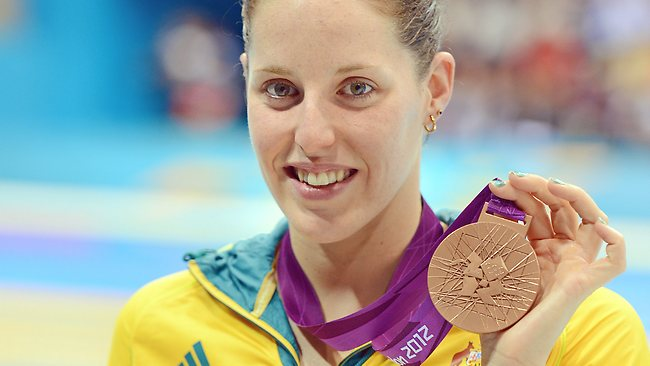 Alicia Coutts shows off her second medal of the London Games. Picture: Michael Dodge