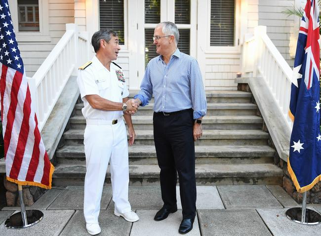 Prime Minister Malcolm Turnbull meets with Admiral Harry Harris at a garden party at joint naval/air force base Pearl Harbor in Honolulu. Picture: Jake Nowakowski