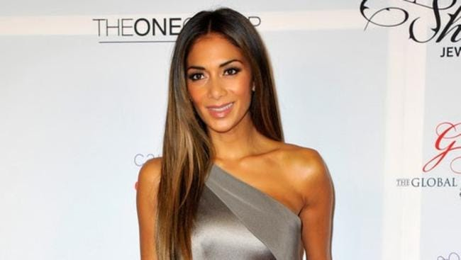 What name does Nicole Scherzinger use when she checks into hotels?