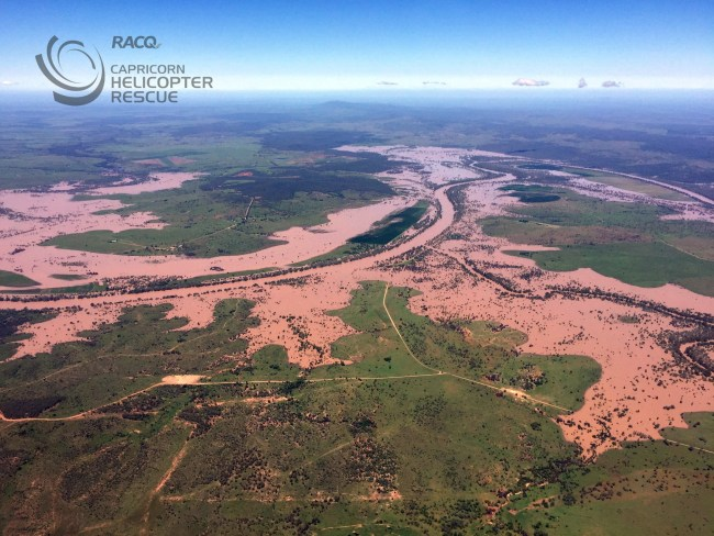 Aerial view shows the flooded Fitzroy River flowing towards Rockhampton at the rate of 1,050,000 megalitres of flood waters a day - or twice the volume of Sydney Harbour.